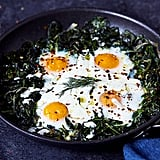 Skillet Baked Eggs With Greens and Feta Yogurt Drizzle