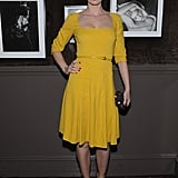 Emily Blunt in a belted yellow dress with a black clutch at the Elie Saab private dinner in NYC.
