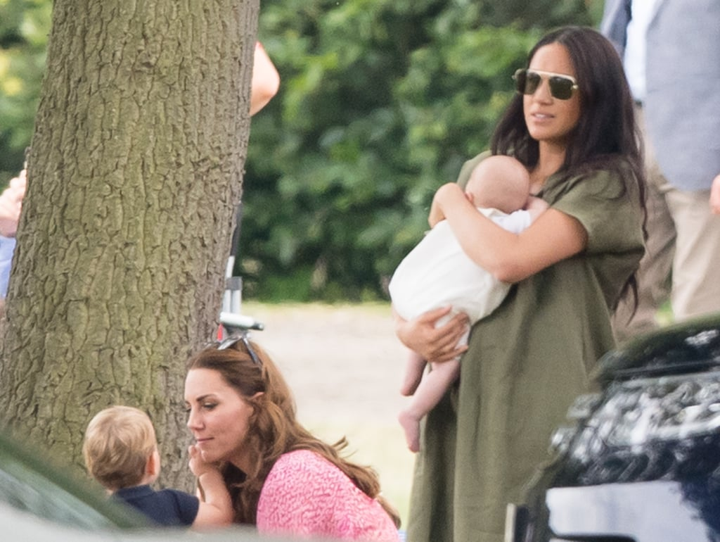 Prince William and Prince Harry had some adorable supporters as they participated in a charity polo match on Wednesday. In addition to having their respective wives, Kate Middleton and Meghan Markle, in the crowd, they also had their kids cheering them on. Meghan was spotted in green, cuddling baby Archie in her arms, while Kate — who was wearing a cute pink Summer dress — tended to her three children, Prince George, Princess Charlotte, and Prince Louis, during the match. Seriously, did they grow up overnight? Louis has already gotten so big; meanwhile, George favors his dad so much now.  We've been blessed with quite a few royal appearances as of late. Kate and Meghan both attended Wimbledon on separate days, and the entire royal family (minus Queen Elizabeth II) joined together for baby Archie's christening. Honestly, we need more play dates between Kate and Meghan's kids, because they are so precious. Read on for the best moments.