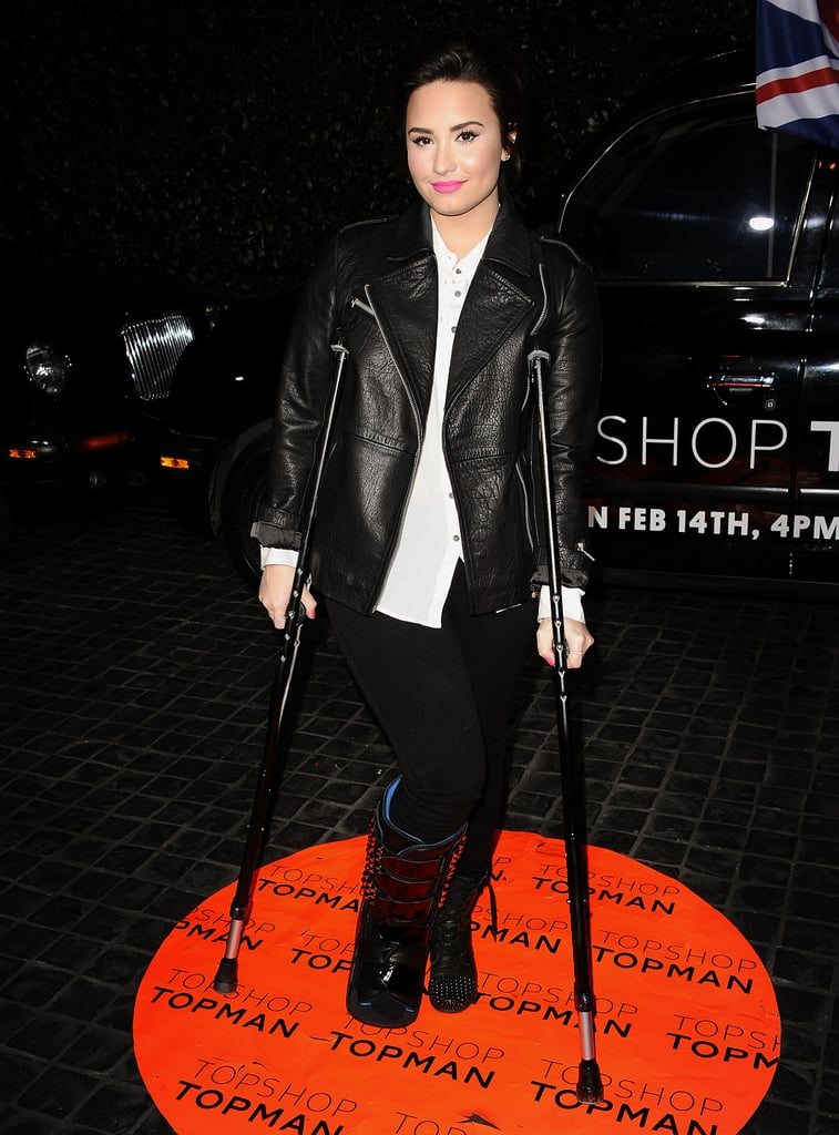 Demi Lovato arrived with crutches.