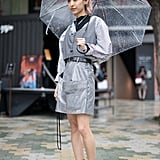 A guest styling a silver minidress with a gray vest during Fashion Week in Tokyo.