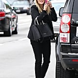 Reese Witherspoon chatted on her phone while getting out of the car in LA.
