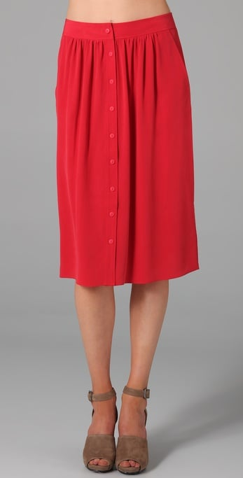 Primary colors: You can't start the season without a bright dose of color. This bright red button-embellished skirt will look amazing with neural accompaniments.   Tibi Midi Skirt With Buttons ($242)