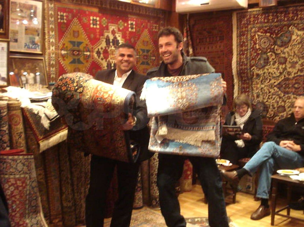 Ben Affleck kindly posed with a rug salesman in Istanbul on Monday while he was in Turkey scouting locations for an upcoming movie. He was taking care of work business, while his wife, Jennifer Garner, was on her own trip to promote Arthur. She flew to NYC for the film's premiere with her costars Russell Brand and Helen Mirren and also made stops at The Late Show and Live With Regis and Kelly. Jennifer chatted about how she and Ben share parenting duties when the other is working. Since they've both been traveling, Ben's mom took care of Violet and Seraphina this time, and the adorable girls hit the park with their grandma earlier this week.