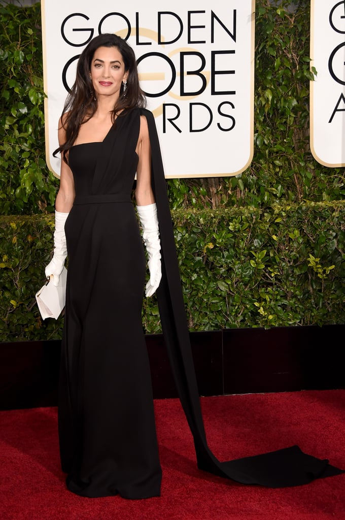 Amal Clooney channelled Old Hollywood glamour in a sleek Dior gown and white gloves in 2015.