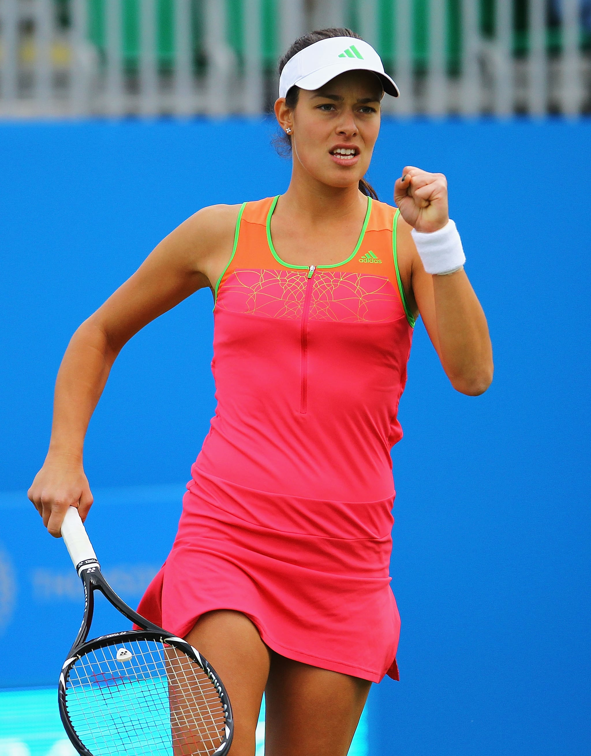 Ana Ivanovic kept up with this seasons neon colour trend in a hot pink, orange, and green dress.