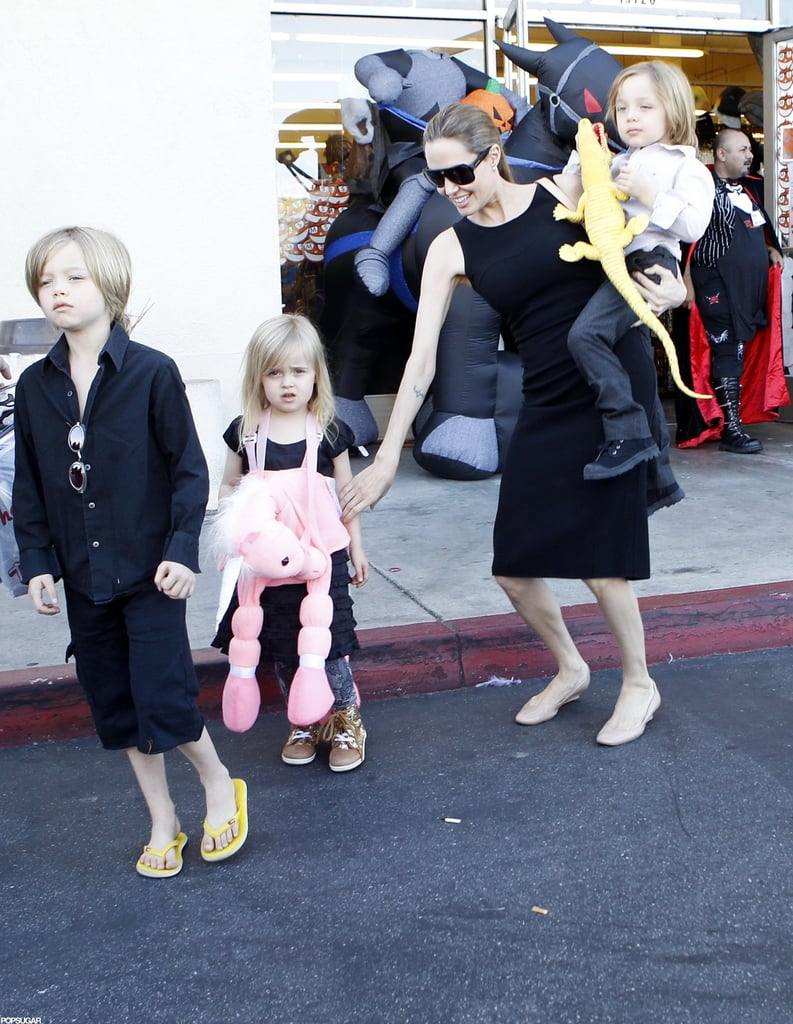 Angelina Jolie carried Knox on her hip as she made her way out of a Halloween store in LA with Vivienne and Shiloh yesterday. Vivienne got a head start on the holiday, wearing a pink unicorn costume, while Knox held onto a toy alligator. The twins had an exciting weekend, also hanging out at a park with friends on Saturday.  The Jolie-Pitts have been spending time on the West Coast after a stint in London, where Angelina filmed Maleficent. Pax, Zahara, and Vivienne all have parts in the Disney movie, which won't be released until 2014. The spotlight has been on Brad lately though, since his Chanel ads were released this month and numerous parodies, including a skit on Saturday Night Live, followed.