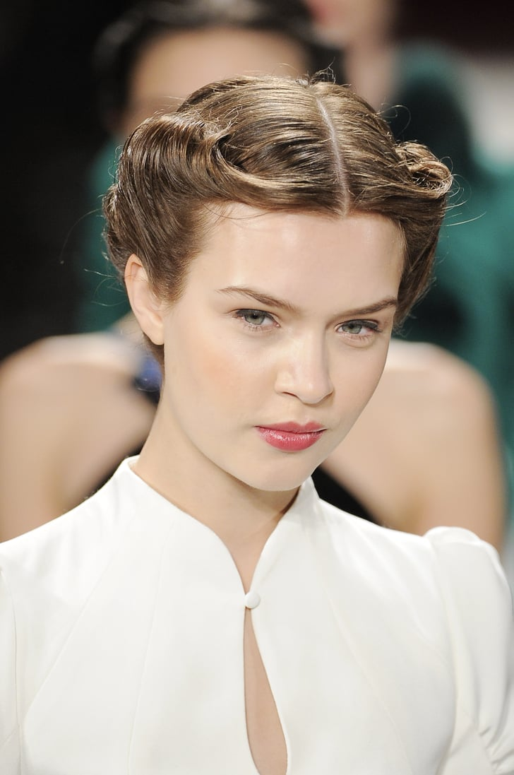 A Chic 40s Style Rolled Updo Kept The Hair Off The Face