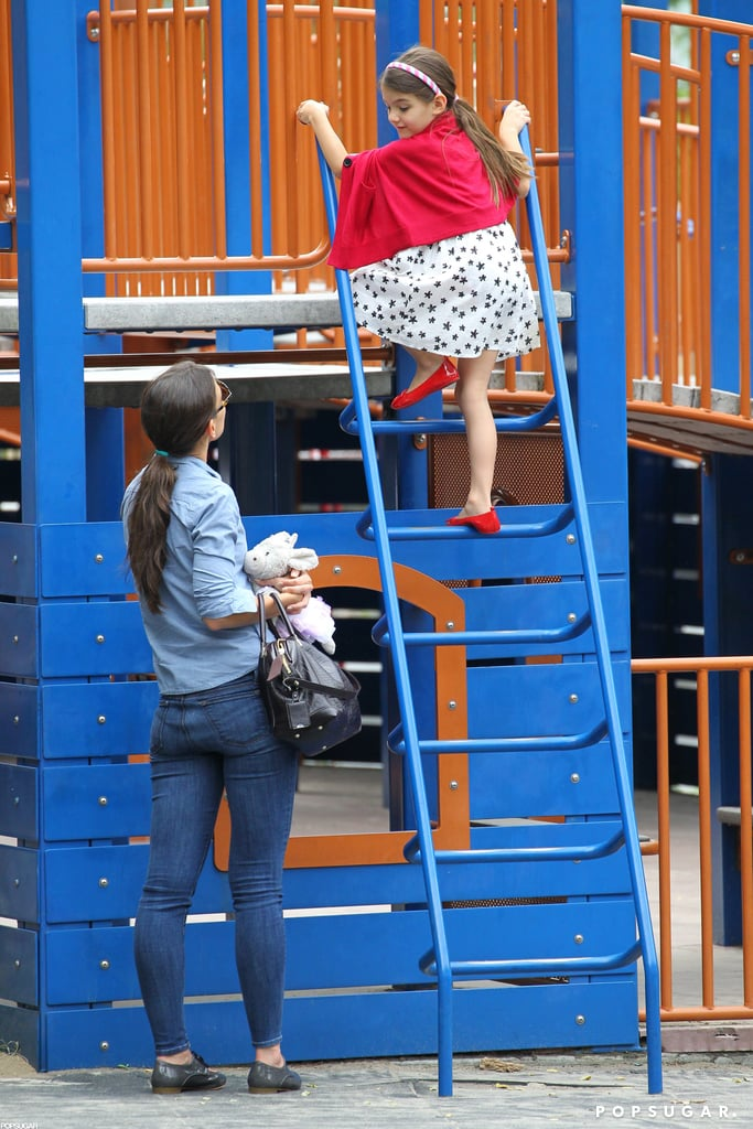 Katie Holmes and Suri Cruise marked Labor Day at a park in Brooklyn yesterday. Suri took turns going down a slide at the playground and even joined a few friends on a tire swing. Katie and Suri's long weekend also included a visit to Chelsea Piers where they were spotted with a new canine companion. While they were on the East Coast, Tom Cruise popped up overseas in Croatia. Katie will be getting back to business soon since she'll show her Holmes & Yang Collection at NY Fashion Week on Sept. 12. The stylish fun gets started this Thursday with the annual Fashion's Night Out celebration that'll have the support of many stars as they party late into the night at retail locations around the world.