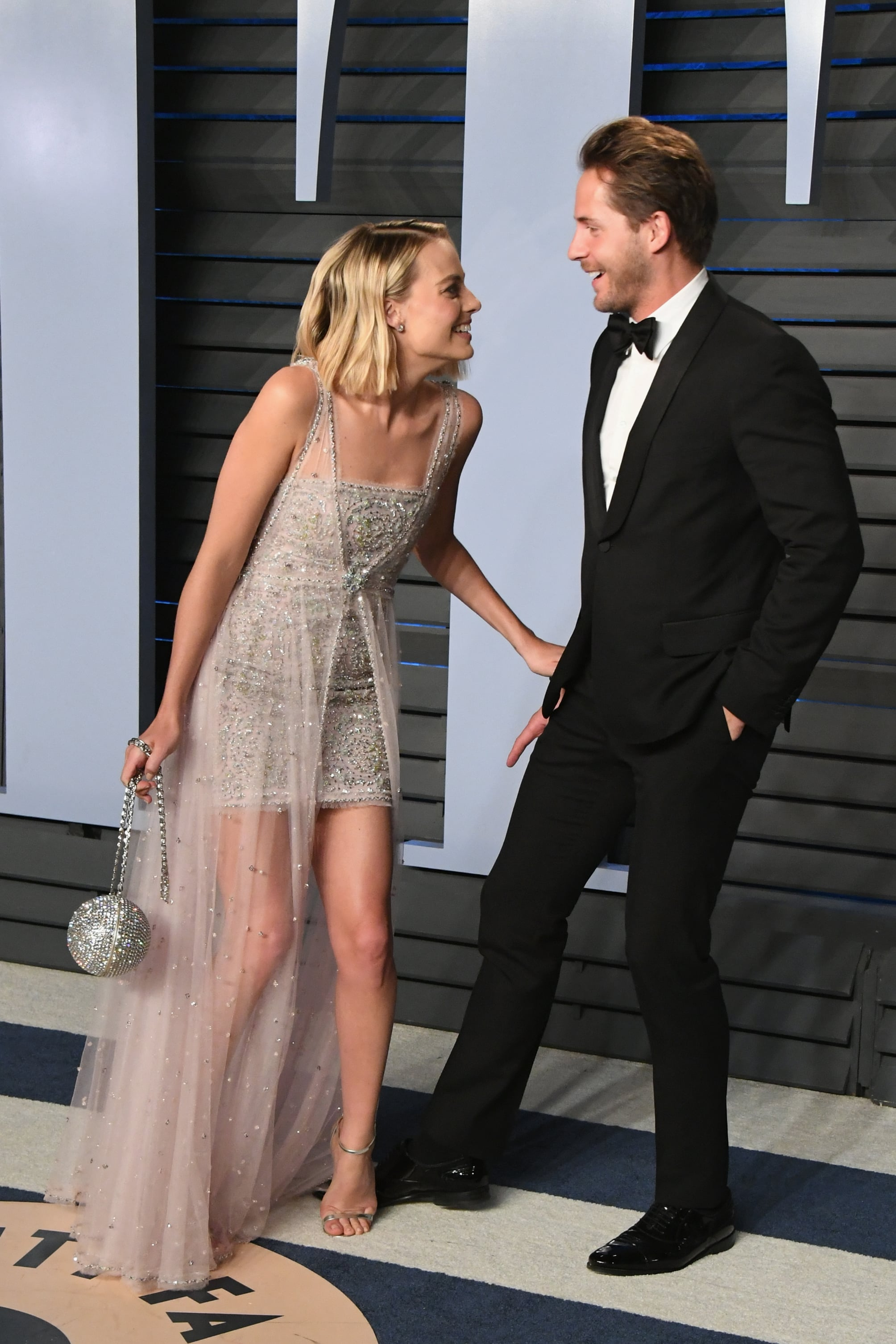 BEVERLY HILLS, CA - MARCH 04: Margot Robbie (L) and Tom Ackerley attend the 2018 Vanity Fair Oscar Party hosted by Radhika Jones at Wallis Annenberg Center for the Performing Arts on March 4, 2018 in Beverly Hills, California.  (Photo by Jon Kopaloff/WireImage)