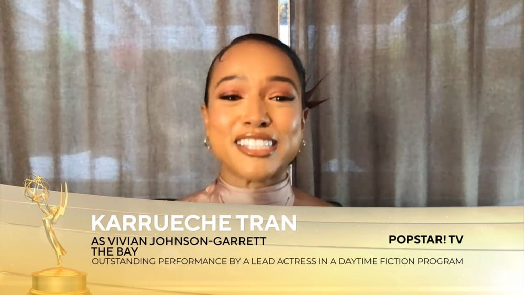 """Karrueche Tran is officially an Emmy winner! During Sunday's Daytime Emmys, the 37-year-old took home the award for outstanding performance by a lead actress in a daytime fiction program for her role as Vivian Johnson-Garrett on POPSTAR! TV's The Bay, making her the first AAPI actress to win a Daytime or Primetime Emmy for the category. Naturally, Tran was overjoyed with her history-making win.  """"I'm so thankful and so blessed and so grateful,"""" Tran said in emotional speech. """"I have to thank my The Bay family who have believed in me since day one when nobody did at all . . . and here we are, I just won an Emmy."""" Tran also shared her excitement on her Instagram Stories, writing, """"I won a f*cking EMMY you guys . . . I just . . . I can't even think straight right now omgggg."""" Congrats again, Karrueche!"""