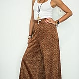 With Printed Palazzo Pants, a Long Necklace, and Gold Sandals