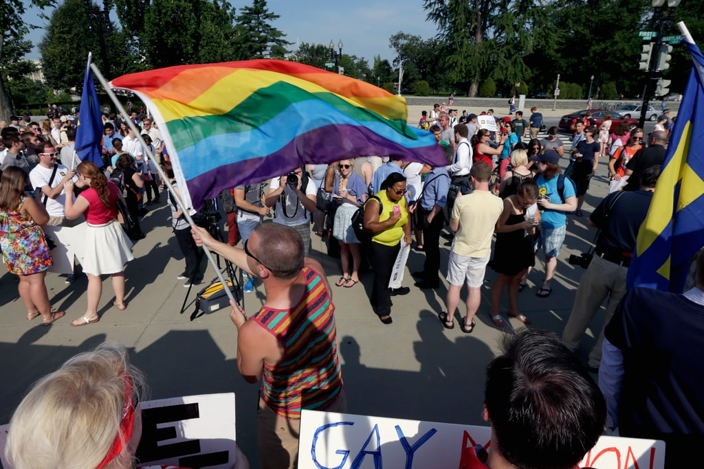 People in Washington DC waved rainbow flags and celebrated gay marriage.