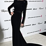 Victoria in a strong-shouldered gown at Elton John's annual Aids Foundation party in 2009.
