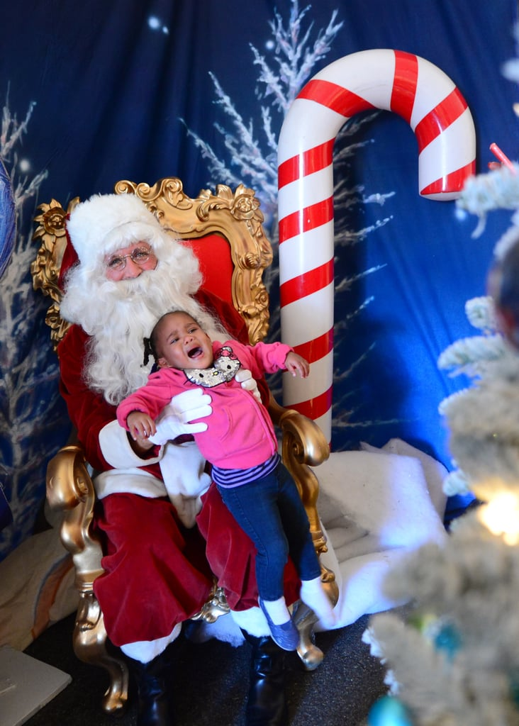 The only thing more terrifying than sitting on Santa's lap is realizing that Santa won't let you run away.