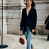 Your black cardigan will look great with jeans and beige boots.