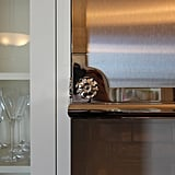 This floral motif is subtly incorporated in molding throughout the unit.