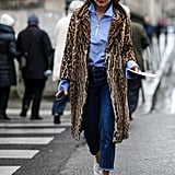 Make your white boots pop by wearing them with a leopard-print coat.