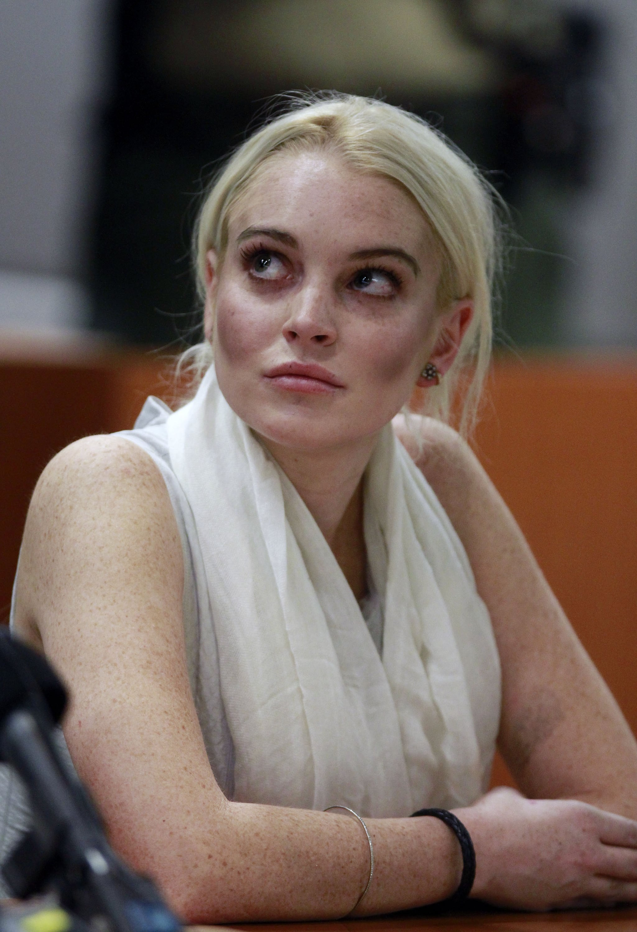 Lindsay Lohan looked to her attorney.