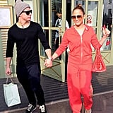 Jennifer Lopez was all smiles as she held hands with Casper Smart.