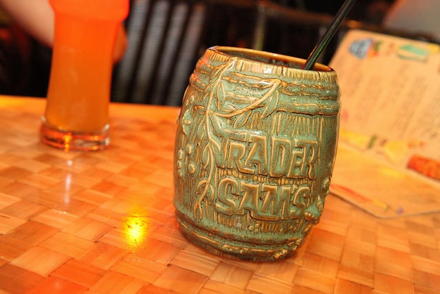 Sip on tropical drinks and watch live music in Trader Sam's at the Disneyland Hotel.