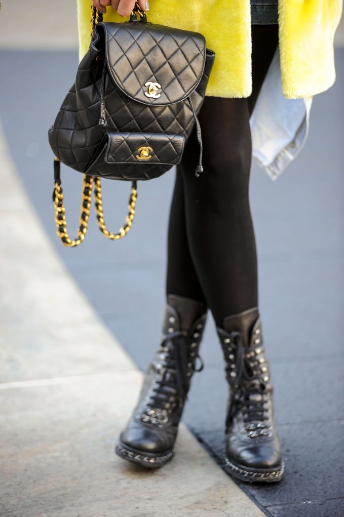 Tough-girl meets fashion fan with a Chanel backpack purse and combat boots.  Source: Gorunway