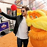 Zac Efron posed with his friend, The Lorax.