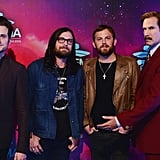 Will Ferrell, dressed as Ron Burgundy, posed with Kings of Leon at the MTV EMAs.