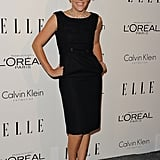 Busy Philipps in a black sheath dress.