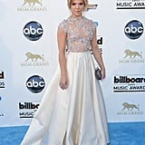 Kimberly Perry, of The Band Perry, went with something much more glamorous, thanks to a princess-like pearl white skirt and embellished bodice combination.