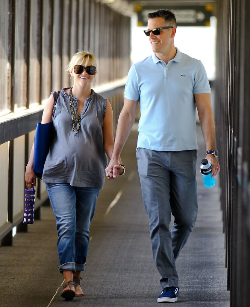 Reese Witherspoon and Jim Toth were all smiled for a hand-in-hand stroll in LA.