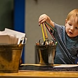 Teach your child how to hold a pencil and other fine motor skills.