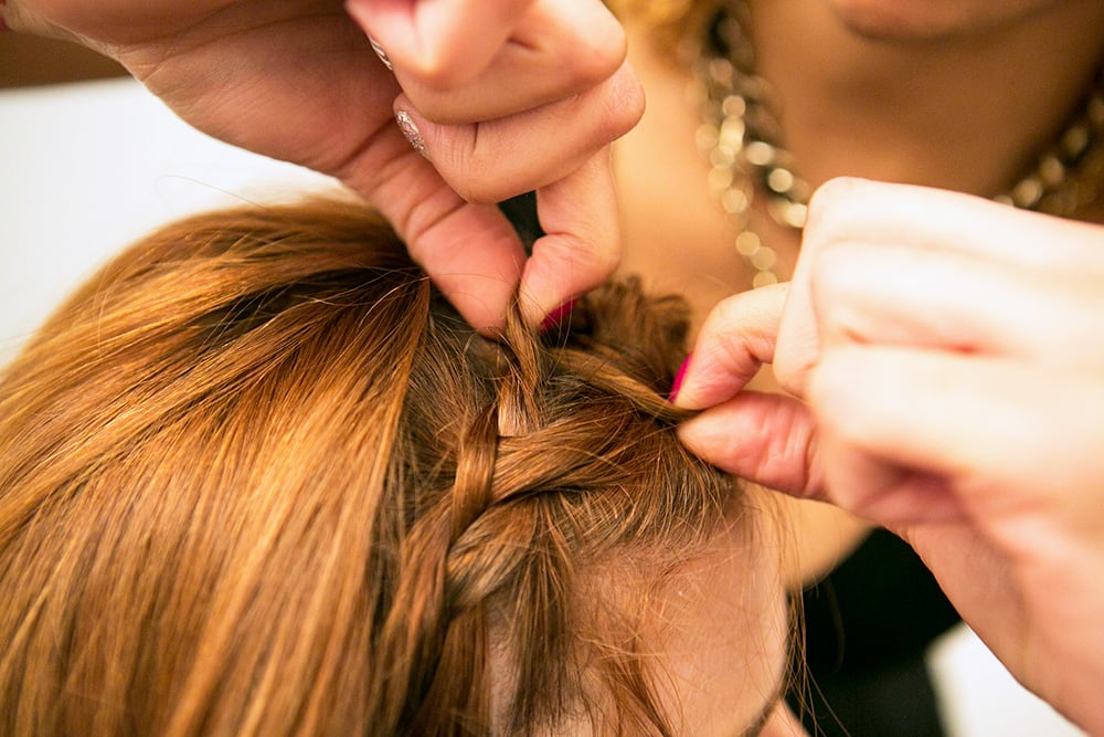 Then, use your fingers to pull the braid apart. This will help give your plait more width and added texture. Source: Caroline Voagen Nelson