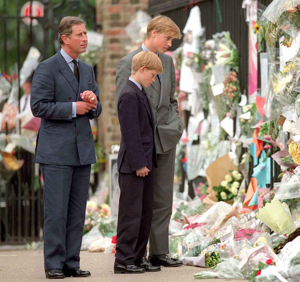 William and Harry stuck side by side as they read cards and tributes to their mother, Princess Diana, during her funeral procession in September 1997.