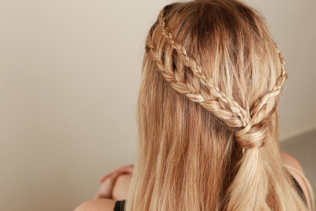 Take the ends and wrap them around a hairpin, and tuck the pin into the center of the braids.