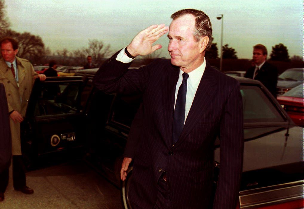 U.S. President George Bush salutes as he leaves the Pentagon 14 December 1992. Bush was briefed by U.S. Defense Secretary Richard Cheney and Chairman of the Joint Chiefs of Staff General Colin Powell on the current situation of U.S. relief efforts in Somalia.         (Photo credit should read RENAUD GIROUX/AFP/Getty Images)
