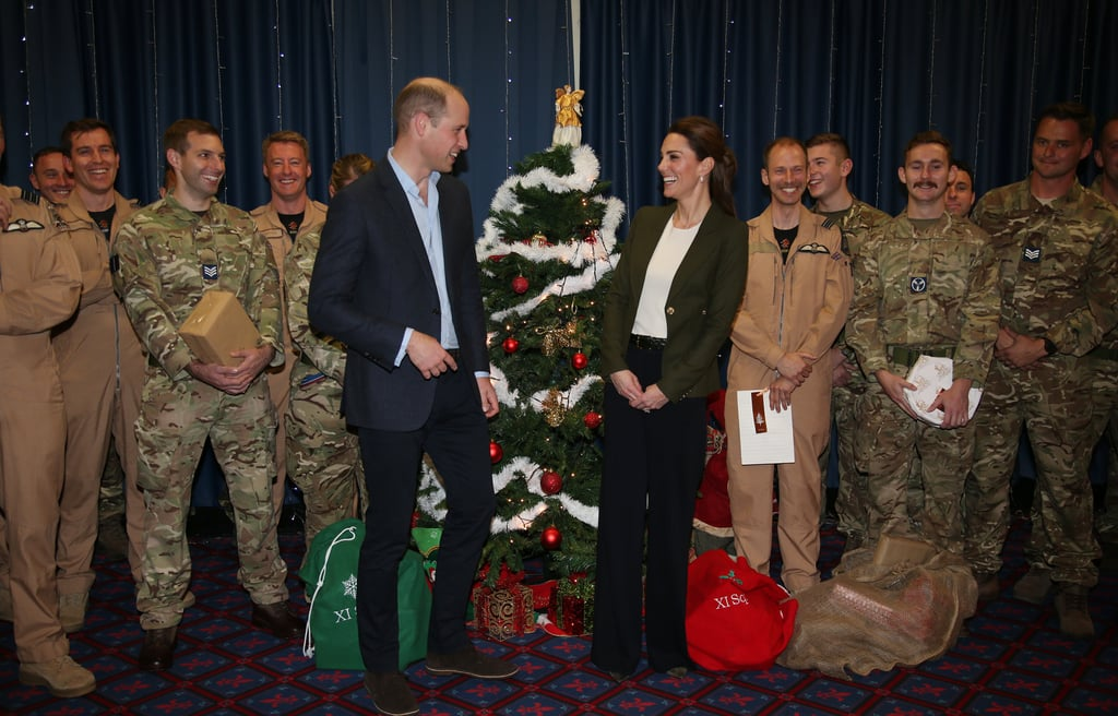The Duke and Duchess of Cambridge continued their busy week on Wednesday when they touched down at RAF Akrotiri in Cyprus. On Tuesday, the royal couple hosted a Christmas party at Kensington Palace for the families of serving personnel on the island. The following day, they flew to the Mediterranean isle to visit their base. During their visit, the couple met serving personnel (including the parents of some of the children they bonded with the day before), along with families, staff, and members of the local community. The festive season is a notoriously busy time for the royals, and William and Kate have definitely hit the ground running this December. Between the two festive events, the couple also found time to attend the queen's Diplomatic Reception on Tuesday evening. Kate stunned at the formal event, wearing an embellished gown and a tiara. Her look the following morning was a little more down to earth, as befitting the location. On arrival, she and William were quickly surrounded by RAF personnel, and the royal couple looked excited to meet the people they'd heard so much about the day before. Keep reading to see all the photos from their visit.