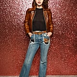 Selena wore Coach from head to toe to attend the brand's Spring 2018 presentation in New York City. She worea pair of '70s-inspired jeans with patchwork on the front pockets, a black crop top, and a leather moto jacket.