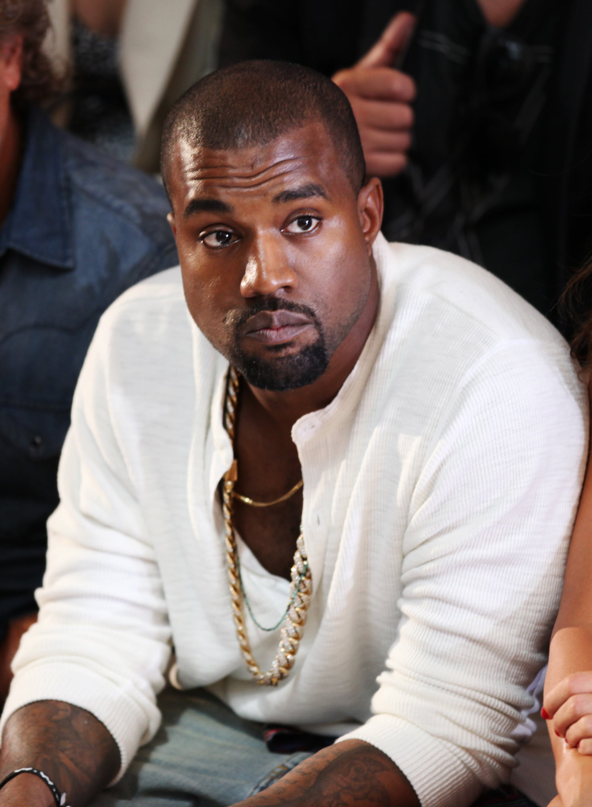 Kanye West took his front row seat at Tuesday's Diesel Black Gold show.