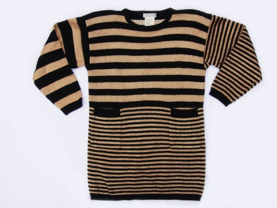 This vintage sweater will put you ahead of the class. Mixed Stripe Metallic Sweater Tunic ($35)