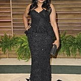 Mindy Kaling walked the carpet in a curve-hugging black dress.