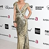 Marisa Miller capitalized on the night's glamorous occasion in an all-over gold sequined gown.