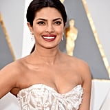 "POPSUGAR: What is the best part of working with Priyanka? Castillo: The best part is her overall attitude. She's been in the industry for a long time working in media, and she likes to have fun with her look. She doesn't want to be boring; she's always pushing my creativity to the next level and keeps me on my toes. That's a gift from a client because you don't want to get too comfortable in what you're doing. PS: What was the getting-ready atmosphere like? C: We were playing music — we were playing Zayn Malik's ""Pillowtalk"" and Rihanna's ""Work"" on repeat. We both love the upbeat, top 40 music so it helps that we're on the same page. We love the popular songs like the new Coldplay and Beyoncé. We were both drinking lots of coconut water because we both have really long days going into really long weeks. We're each hopping on flights to the East Coast tonight to work tomorrow morning. Priyanka kept it very healthy today eating protein and veggies, in comparison to her usual In and Out Burger order. PS: What inspired the hair for her Oscars look? C: We wanted to change it up from what we usually do, especially what we've done this awards season, and we took a risk that worked out really well. We usually do a high/tight ponytail and a side part so we did the opposite — a low, loose pony with a middle part. As a hair artist, I get inspired by the dress, especially with this dress baring the shoulders and the opulent earrings. We wanted to do an effortless glam look as a team but something that would sustain the whole night. The dress and the jewelry stand alone and we didn't want to compete with them."