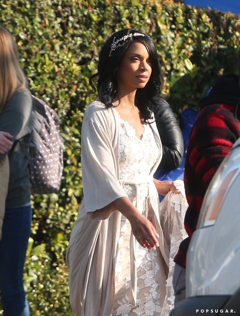 Get ready for another wedding ceremony on This Is Us! After Kate and Toby tied the knot last season, it looks like another Pearson family member will be walking down the aisle in season three. On Friday, cast members Chrissy Metz (Kate), Susan Kelechi Watson (Beth), Justin Hartley (Kevin), Sterling K. Brown (Randall), and Mandy Moore (Rebecca) were spotted filming what appears to be a wedding scene, but just which character is getting married?  It's obviously not Kate since she is already married, but it's possible that Randall and Beth are renewing their vows. Maybe after their relationship woes this season, they decide to start fresh. Watson was spotted wearing an off-white gown, after all. Although, the most likely character getting married is probably Kevin. He has gotten pretty close to Zoe throughout this season, and seeing as actress Melanie Liburd isn't pictured on set, they could be trying to save the surprise (and the reveal of her wedding dress) for the actual episode. That could also explain Watson's fancy getup — she's the matron of honor for her cousin! Of course, we're still not sure why Moore is wearing her '90s era Rebecca wig. Wow, we have a lot of theorizing to do.  Related: Why Is Everyone Going to See Rebecca on This Is Us? 5 Possible Theories