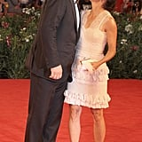 John C. Reilly kisses his wife, Alison Dickey, on the red carpet for the Carnage premiere.