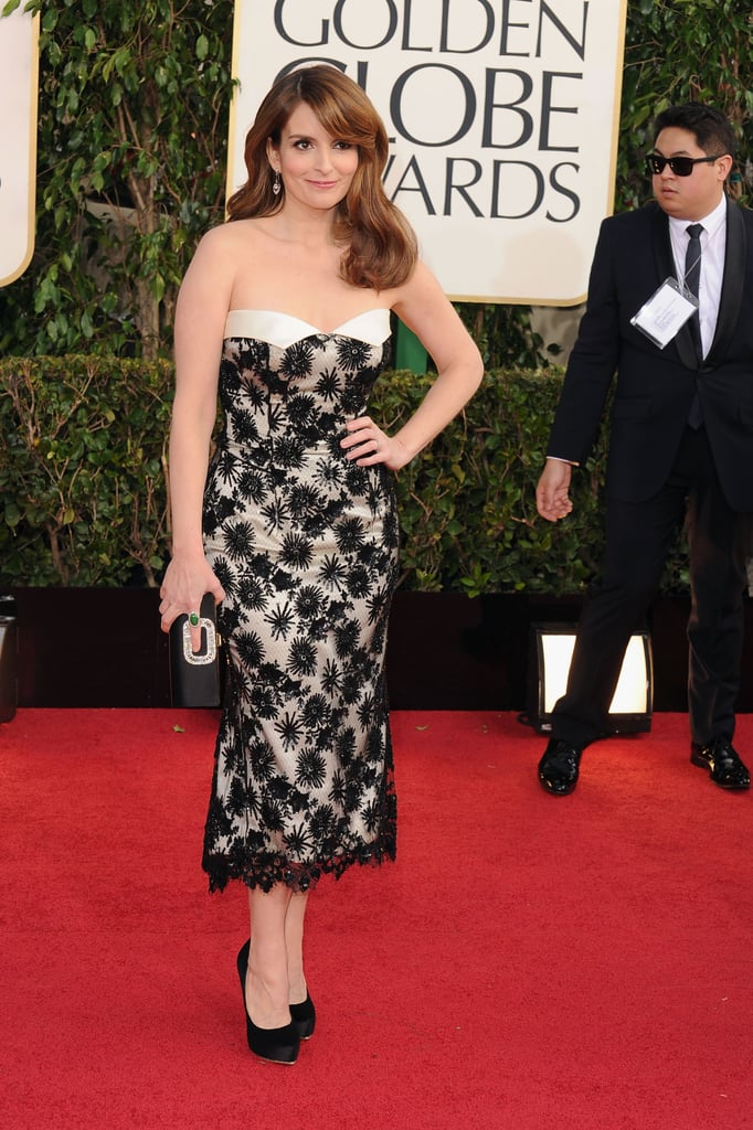 """Host Tina Fey arrived in style when she walked the red carpet at the 2013 Golden Globe Awards in LA today. The actress wore a custom L'Wren Scott dress. Tina will be co-hosting the event with friend and fellow funny lady Amy Poehler, and the two have promised big things for the show. Tina told reporters earlier this week that she hopes some drunk star antics will help make the show a memorable one. """"It's our job [as hosts] to keep things moving and also try to get the movie stars more liquoured-up so that hopefully someone's boob will fall out of a dress. That's our main role."""" Tina Fey is also nominated for best actress in a TV series for 30 Rock. Be sure to check out our red carpet polls to weigh in on your favourite Golden Globes fashion."""