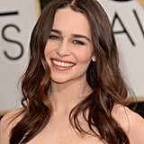 """I was so inspired by Emilia's Proenza Schouler gown,"" Dove celebrity hairstylist Mark Townsend said. ""The mix of embroideries looked like movement, so I wanted her hair to move beautifully as well."" He prepped her hair adding a few drops of the new Dove Pure Care Dry Oil Nourishing Treatment ($11) in her damp hair and combing it through. Next, he sprayed Dove Oxygen Moisture Root Lift Spray ($6) to the roots and blow-dried strands with a round brush. Then, he took three-inch sections of hair and wrapped each section around a 1.5-inch curling iron, because a larger barrel creates looser waves instead of tight ringlets. He finished the look with Oribe Dry Texturizing Spray ($39) for texture and Dove Pure Care Dry Oil Nourishing Treatment for shine."