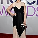 Emily Deschanel's colour-blocked look was matched by her geometric clutch.