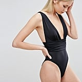 The gathered waistband and plunging neckline on the Asos Gathered-Waist Band Swimsuit ($32) draw attention to your top half.