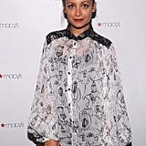Nicole Richie wore red lipstick with her black and white ensemble.